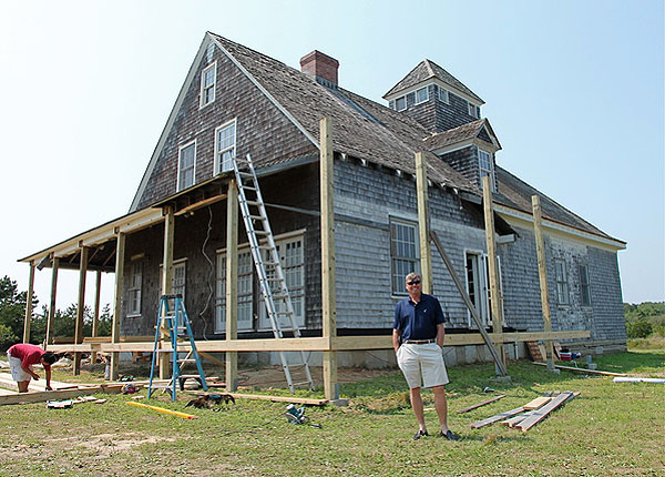 Ben Krupinski's workers started restoring the exterior of the Amagansett Life-Saving Station last week. KYRIL BROMLEY