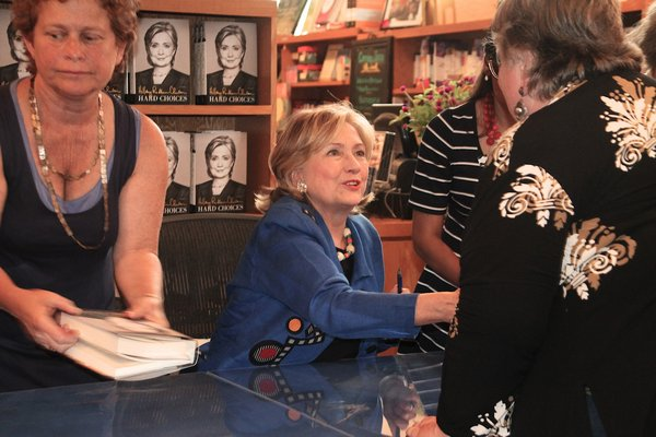 Hillary Rodham Clinton signs copies of her book at BookHampton in East Hamtpn last year.  PRESS FILE