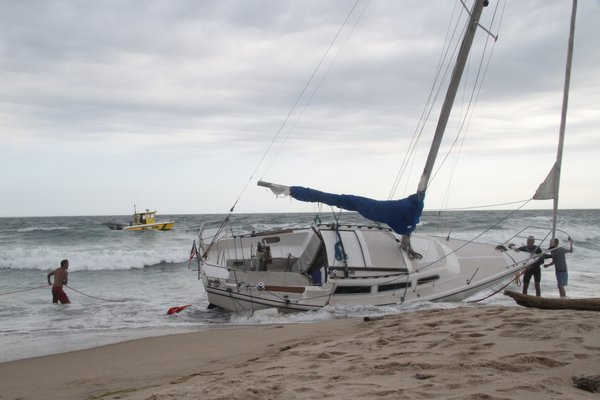 The sailboat Vanna White was pulled off the beach in Montauk on Thursday afternoon. Michael Wright