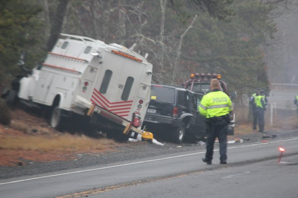 Southampton Town Police and New York State Troopers at the scene of a fatal crash on Flanders Road Thursday morning. BY CAROL MORAN