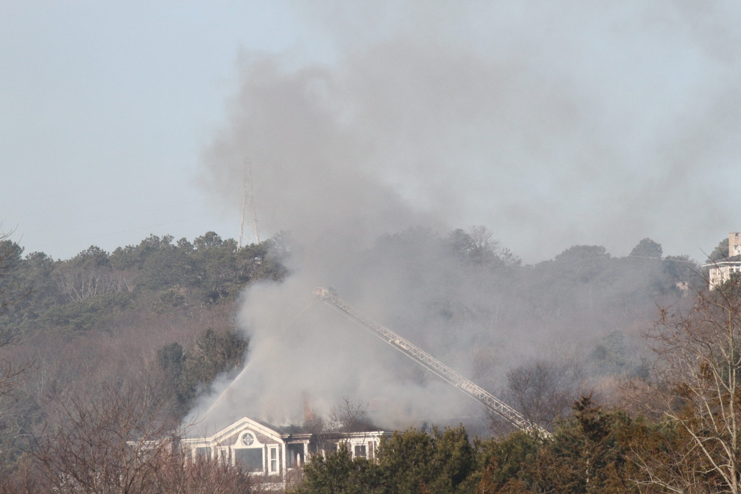 Fire destroyed a Water Mill mansion on Saturday morning. The house was on Little Noyac Path, which does not have fire hydrants, forcing fire crews from throughout the South Fork to rely on tanker trucks to supply the water needed to fight the flames.