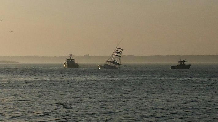 was partly submerged after colliding with a commercial fishing boat about 17 miles off shore on Sunday morning. The Nina Marie was dragged back to shore by Sea-Tow Shinnecock/Moriches while the other boat