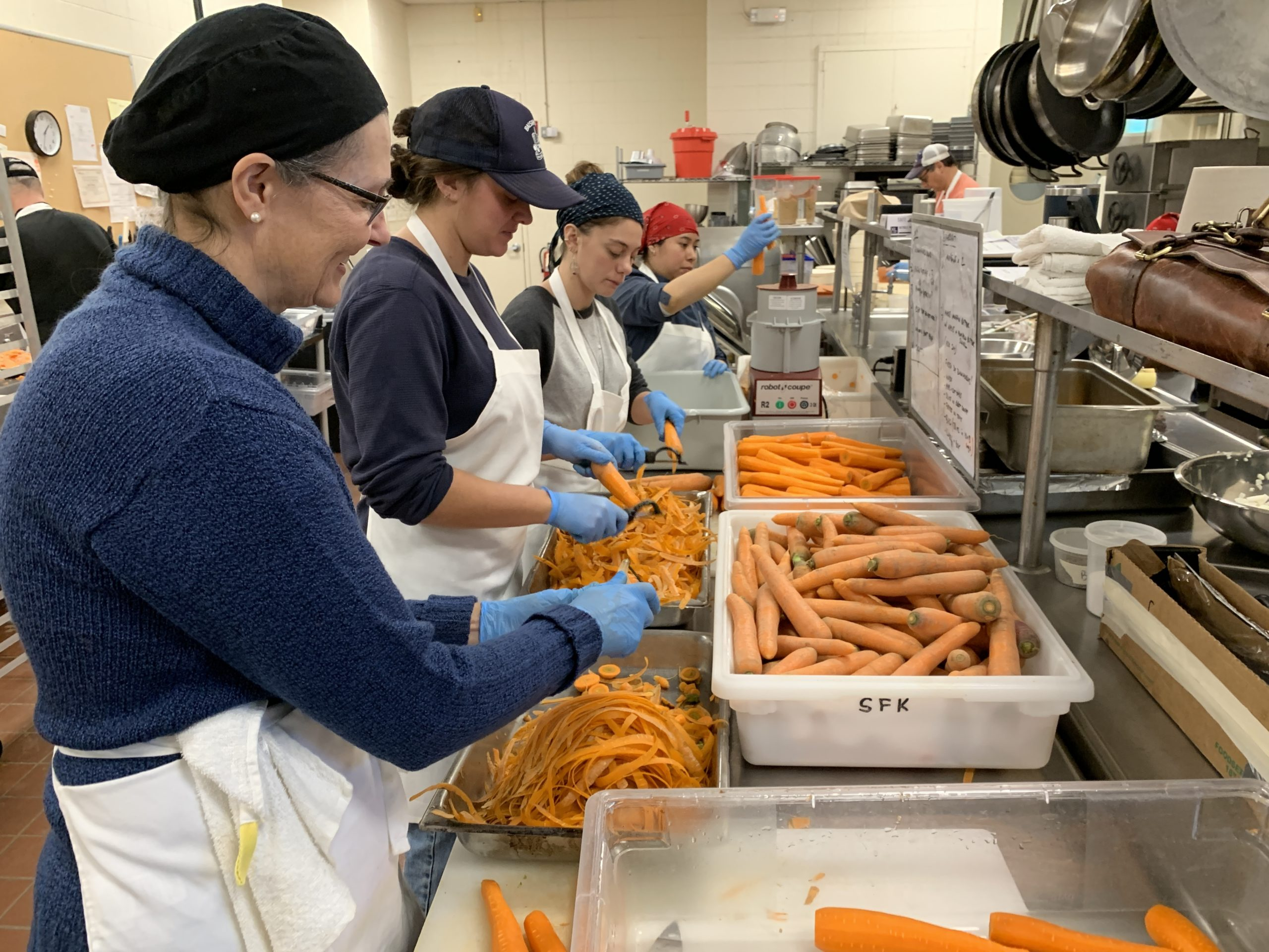 Volunteers helped wash, peel, chop and freeze 1,600 pounds of carrots to be sent to a food bank. KIM COVELL