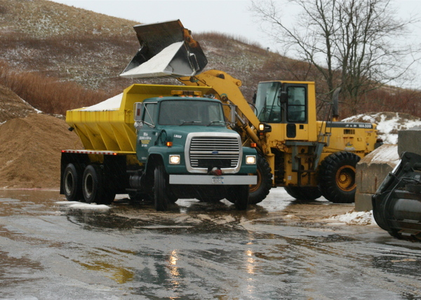 A truck is loaded with salt on Friday afternoon at the East Hampton Town Highway Department yard before the blizzard. KYRIL BROMLEY