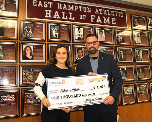 Becca Kuperschmid with Chris Croken of Bethpage Federal Credit Union Bank who presented the East Hampton athlete with a $1