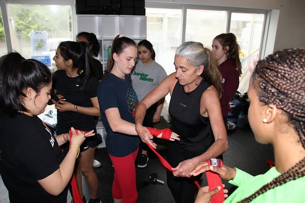 Amy Barletta gets her students ready for a teen boxing training class led by Antoine Waldo. KYRIL BROMLEY