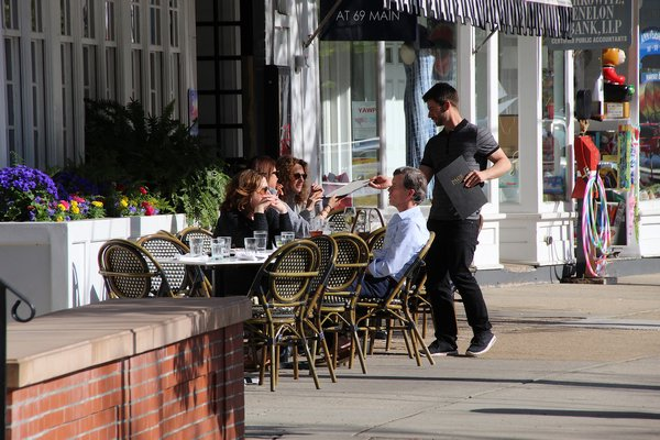 People dining on the streets of Sag Harbor Village on Monday afternoon.  KYRIL BROMLEY