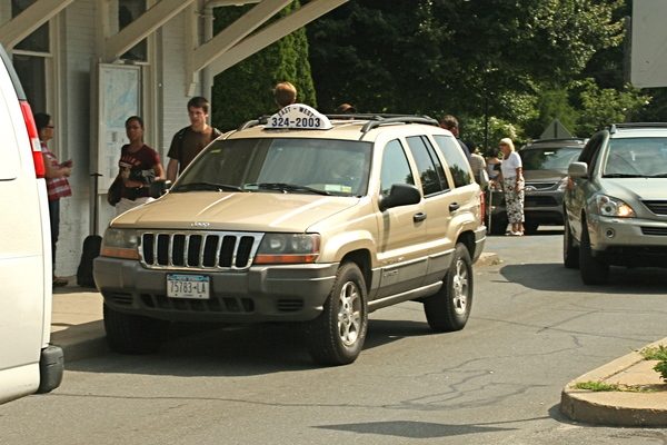 A taxi waits to pick up passengers at the East Hampton train stiation.
