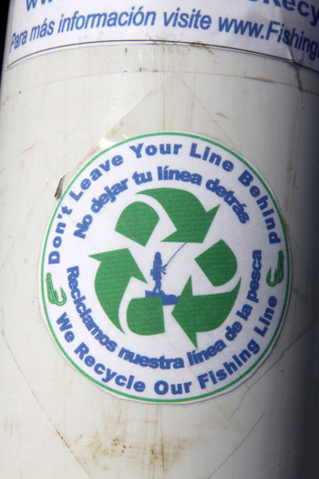 The recycling canisters will have stickers in Spanish and English explaining what they are for.