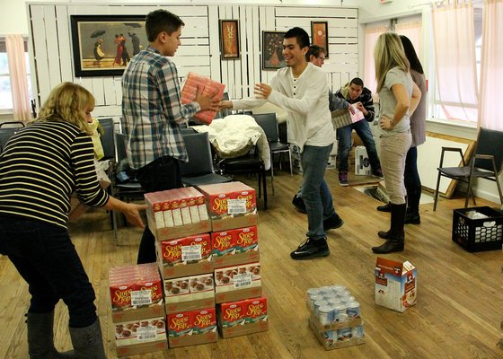 Volunteers pack bags of food for the Thanksgiving holiday at the East Hampton Food Pantry on Monday. KYRIL BROMLEY