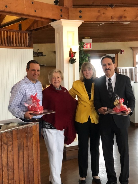 The Hampton Bays Beautification Association presented its annual awards at its holiday party last week. FMichael Braun of Silver Bay Lending, left, and Kenneth Pagano of Allstate Insurance were given the group's Community Beautification Award for 2019. ValerieZuccarelli and Susan von Freddi, second from right, made the presentation.