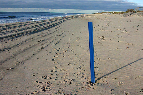 Beach markers are being placed along the shoreline to help identify the location of swimmers in trouble.