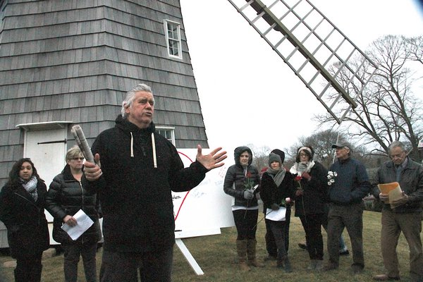 A vigil at Hook Mill in East Hampton on Saturday honored those who were killed in the school shooting in Parkland