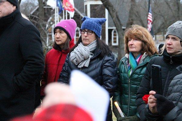 Gerry Mooney speaks at Saturday's vigil at Hook Mill in East Hampton.    KYRIL BROMLEY