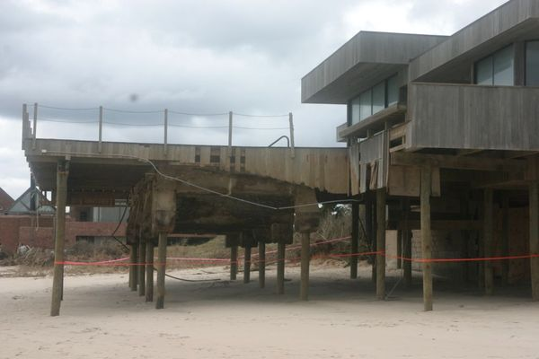 Some homes sustained structural damage that will have to be repaired before the foundations can be covered with sand again.  MICHAEL WRIGHT