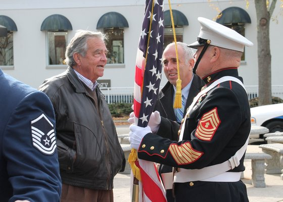 Mayor Paul Rickenbach and Suffolk County Legislator Jay Schneiderman chat with U.S. Marine Brian Carabine. KYRIL BROMLEY PHOTOS