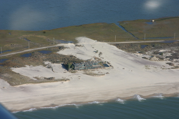 The storm waves washed over the barrier islands in many places