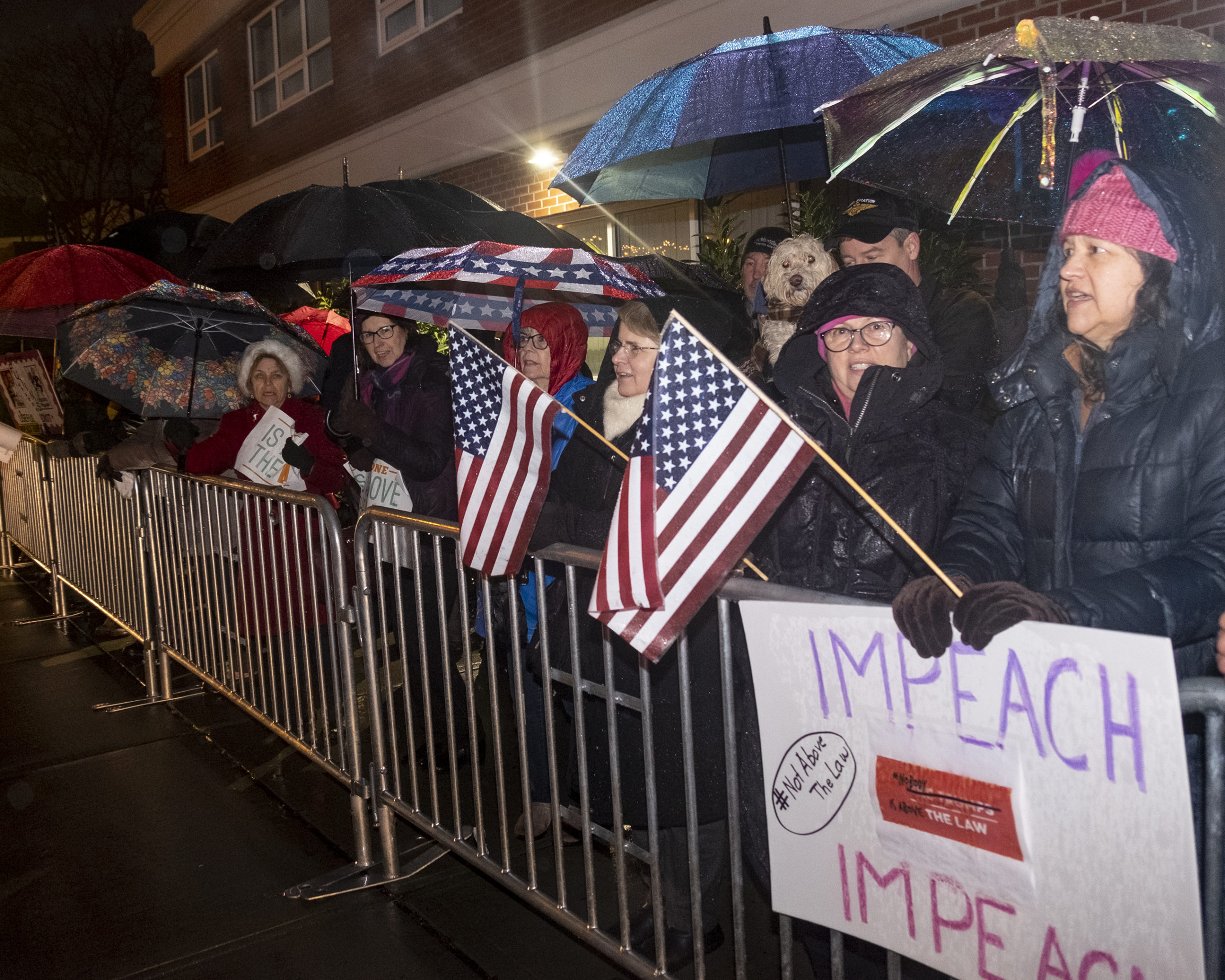 Protesters gathered outside U.S. Representative Lee Zeldin's offices earlier this week to demand he vote in favor of impeachment.