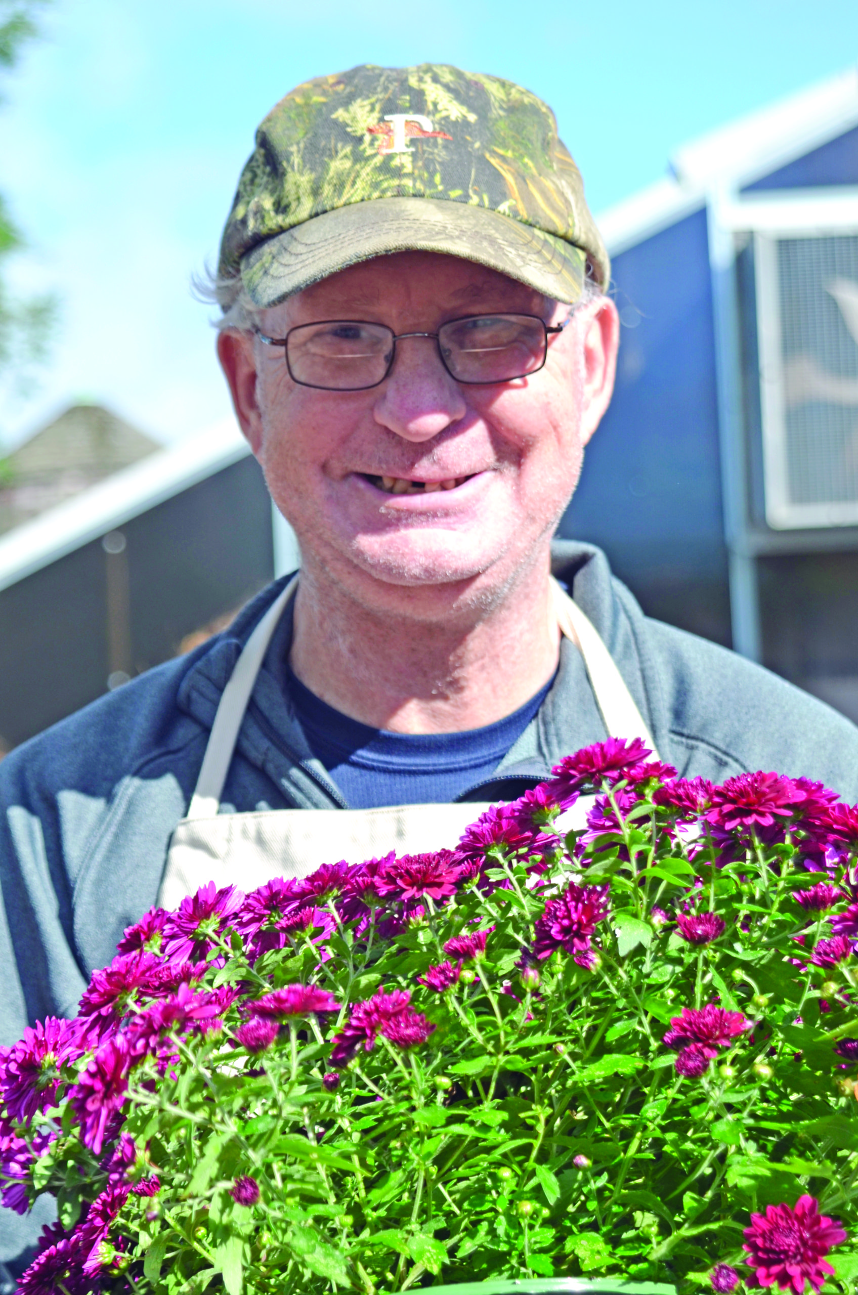 An employee at Smile Farms in Moriches. KIM COVELL