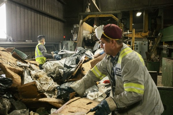 Material solid waste (MSW) and construction debris are processed on two separate belts at Paumanok Environmental in Yaphank. Much of the East End's garbage ends up in this facility. JOSEPH P. LOUCHHEIM