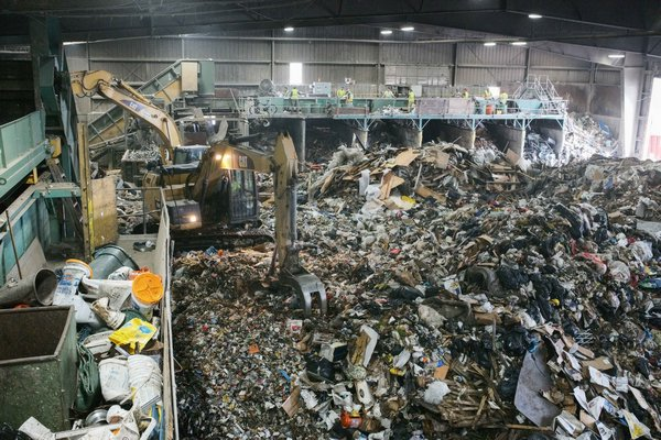 A team of four men is responsible for recovering any recyclables of value (mainly cardboard) from the waste stream at Paumanok Environmental in Yaphank. JOSEPH P. LOUCHHEIM