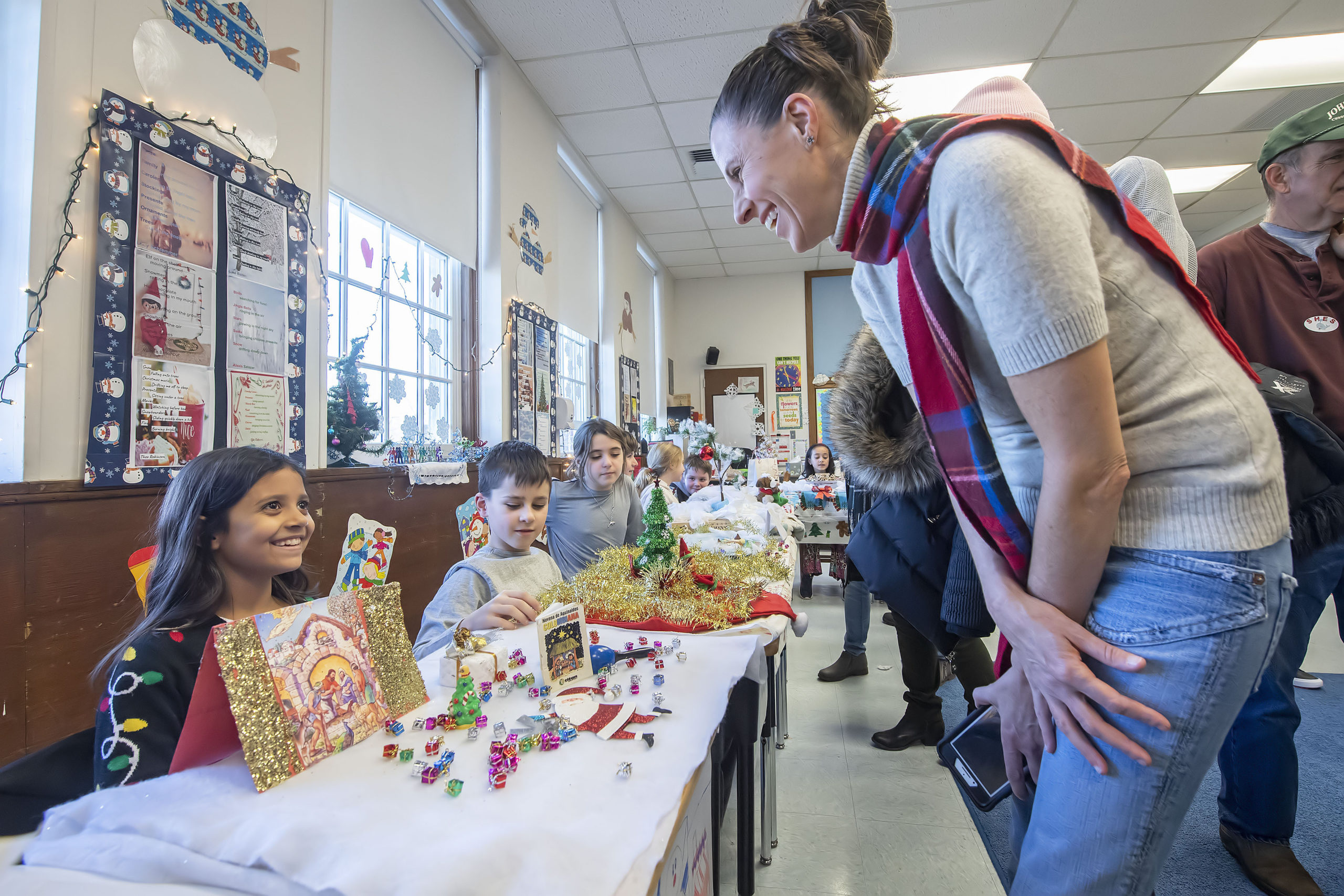 Erin Yaeger checks out Alexis Salazar's display depicting Baby Jesus during the annual Winter Museum Showcase event held by 4th Graders at the Sag Harbor Elementary School on Thursday morning.    MICHAEL HELLER
