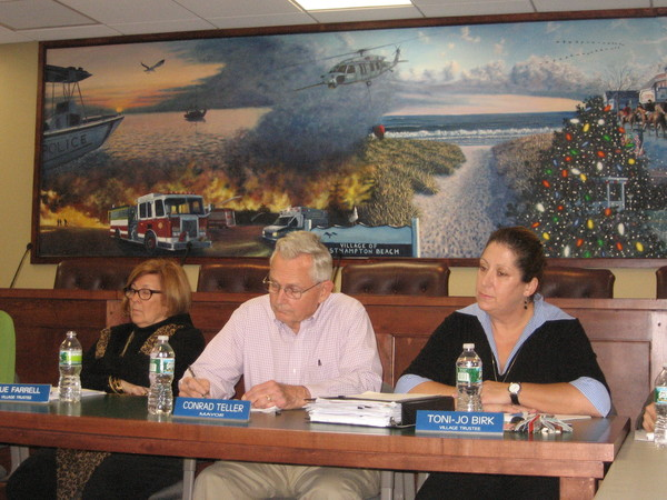 Westhampton Village Mayor Conrad Teller is standing solidly by Trustee Sue Farrell (left)