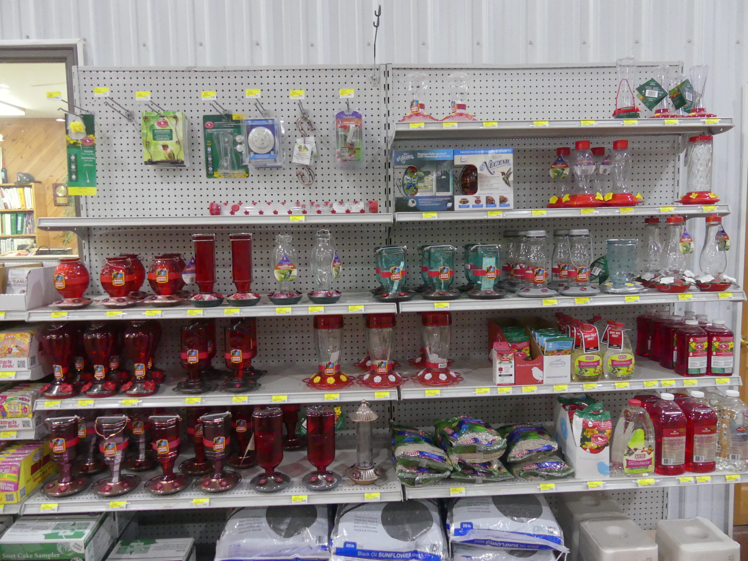 """This store had more than a dozen hummingbird feeders to choose from. They are simply reservoirs of sugar water that the birds sip. There's no need to buy special """"nectar."""" Just follow the instructions for making a sugar and water brew."""