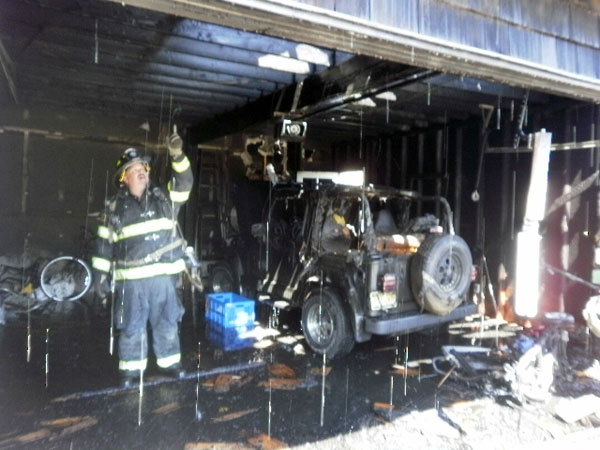 Members of The Westhampton Beach Fire Department  put out a fire after  Hurricane Irene. COURTESY WHB FIRE DEPARTMENT