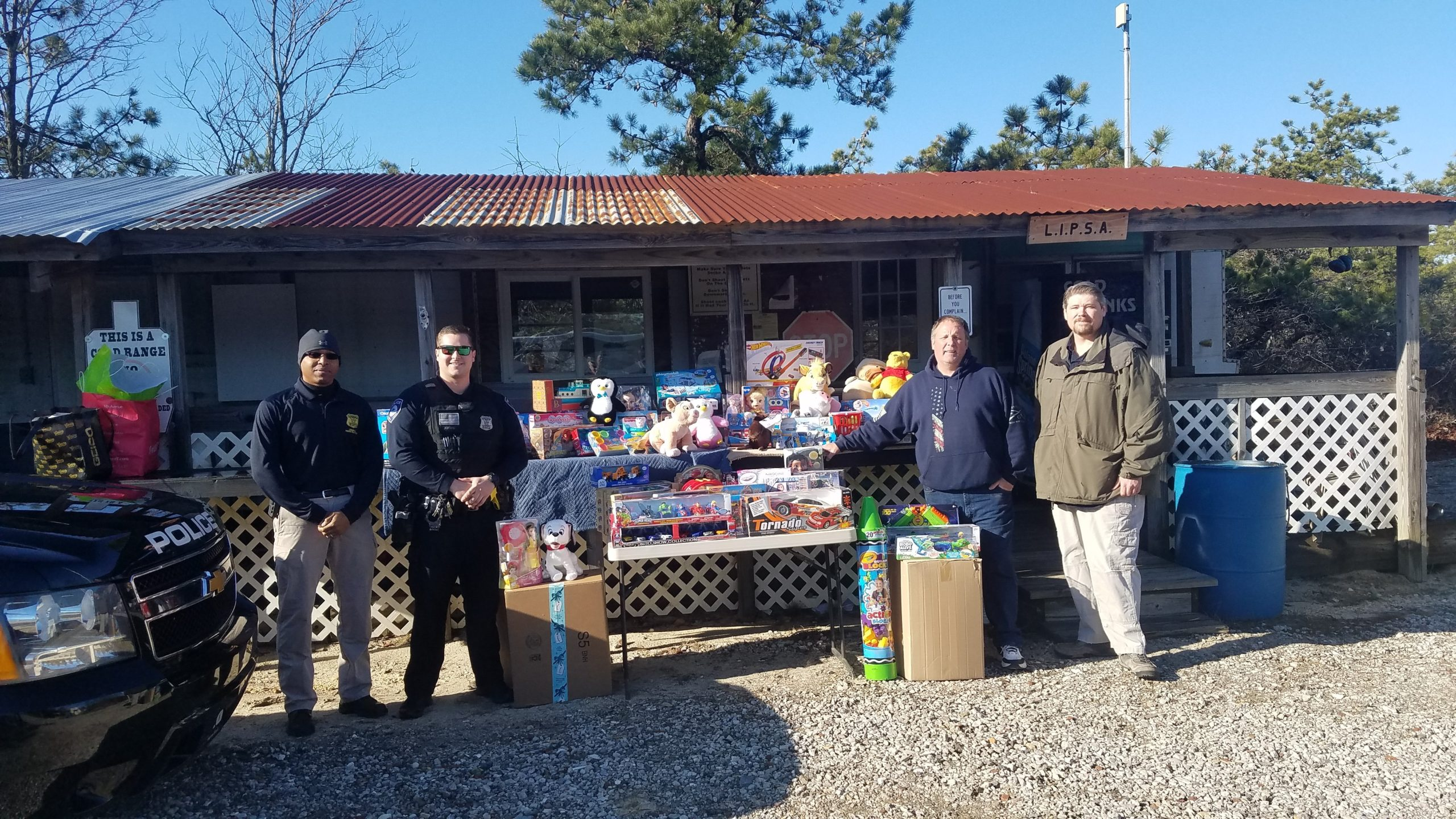 Westhampton Beach Police Benevolent Association President Detective Brian Prescott, Secretary Officer Andrew Kirwin, Vice President of Long Island Practical Shooters Association James Byrne and member of LIPSA Nicholas Schillaci gathering toys to donate for the holidays.