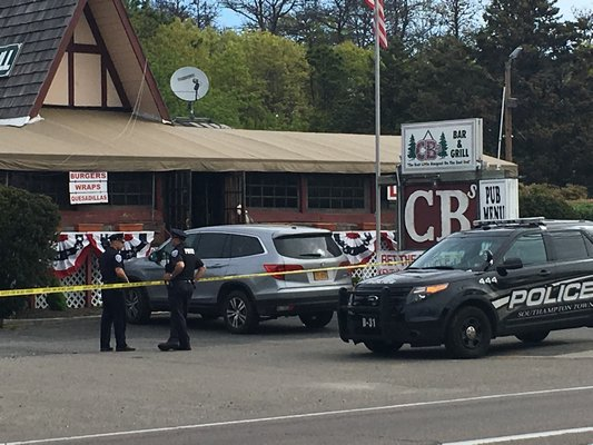 Southampton Town Police detectives investigate a double-stabbing at CB's Bar and Grill in Hampton Bays on Saturday morning. DANA SHAW