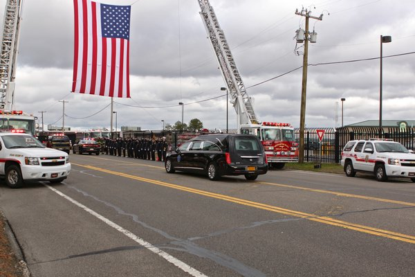 The body of 31-year-old Air National Guard hero serviceman Sgt. Louis Bonacasa of Coram landed at Gabreski Airport in Westhampton Beach on Thursday morning. He was one of six service members killed in a suicide attack in Afghanistan. He was honored by numerous fire departments lining County Road 31 with flags and standing at attention. His funeral will be held Saturday morning at New Beginnings Christian Center in Coram followed by burial a