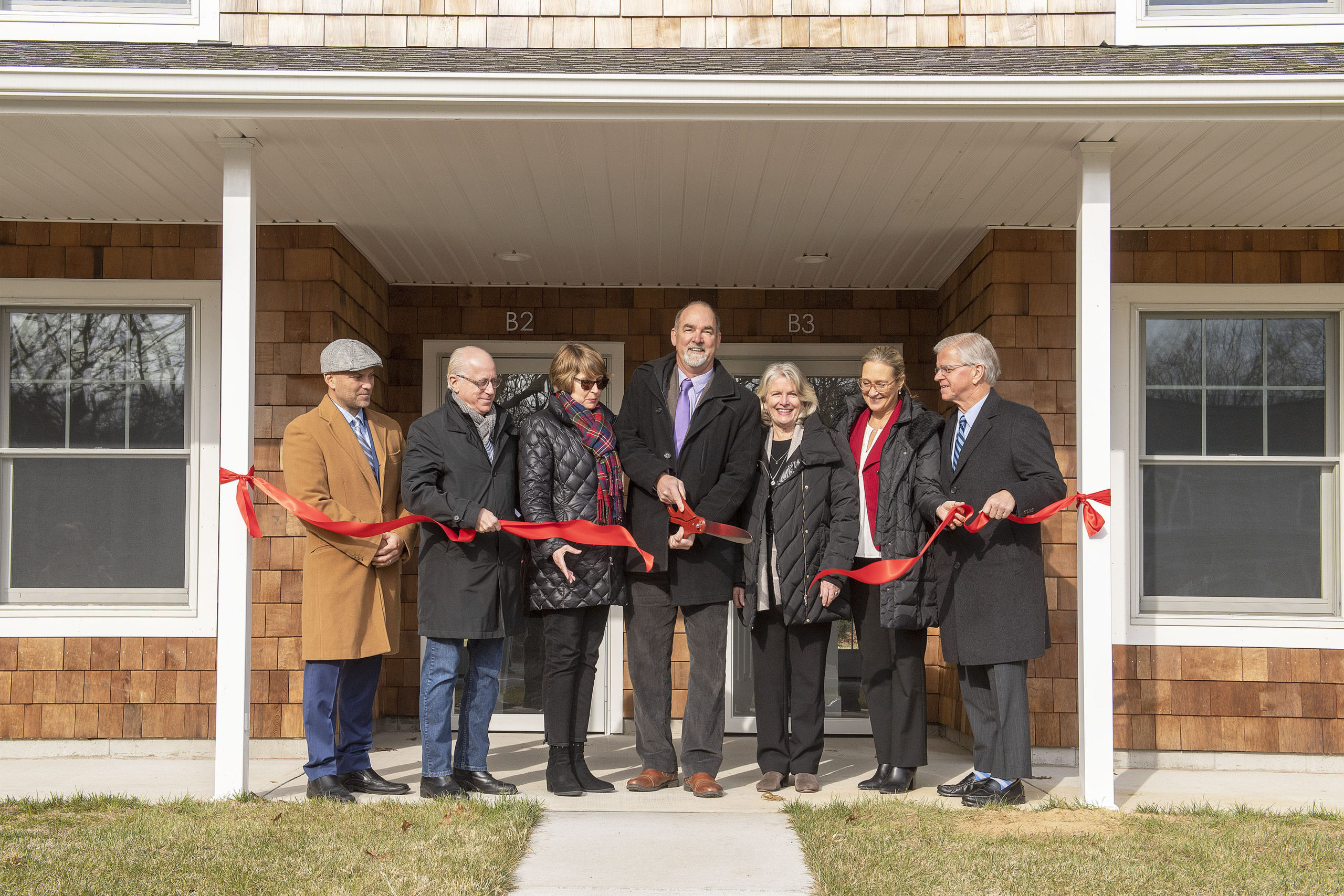 A ribbon-cutting ceremony was held to inaugurate the new condominiums at 181 Accabonac Road as part East Hampton Town Affordable Housing Project on Friday. In attendence were, left to right, East Hampton Town Board Members David Lys, Jeffrey Bragman and Kathee Burke-Gonzalez, East Hampton Town Supervisor Peter Van Scoyoc, East Hampton Town Board Member Sylvia Overby, Suffolk County Legislator Bridget Fleming and New York State Assemblyman Fred Thiele.
