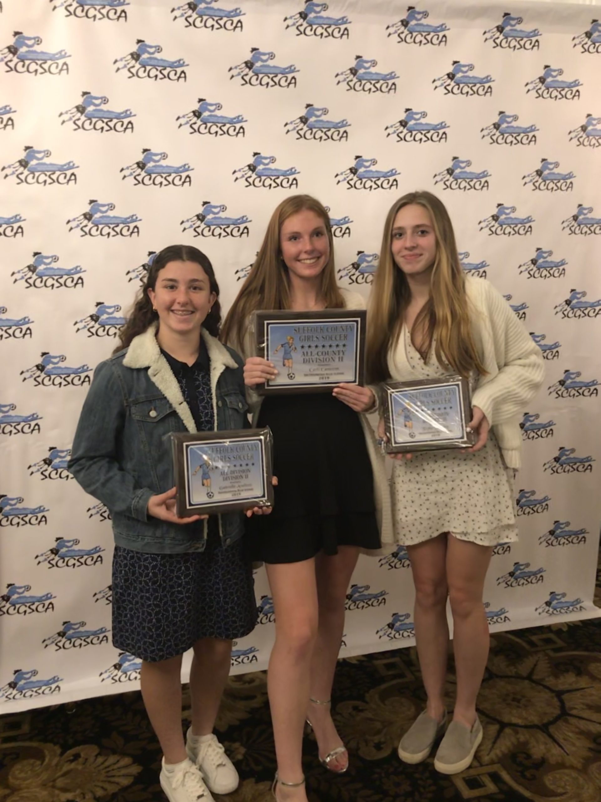 Southampton High School girls varsity soccer players, from left, Ellie Avallone, Carli Cameron and Taylor Zukowky were recognized at the Suffolk County Division II Awards Dinner on November 26 at Villa Lombardi's in Holbrook. Avallone and Zukosky received All-Division awards, while Cameron was honored with All-County.