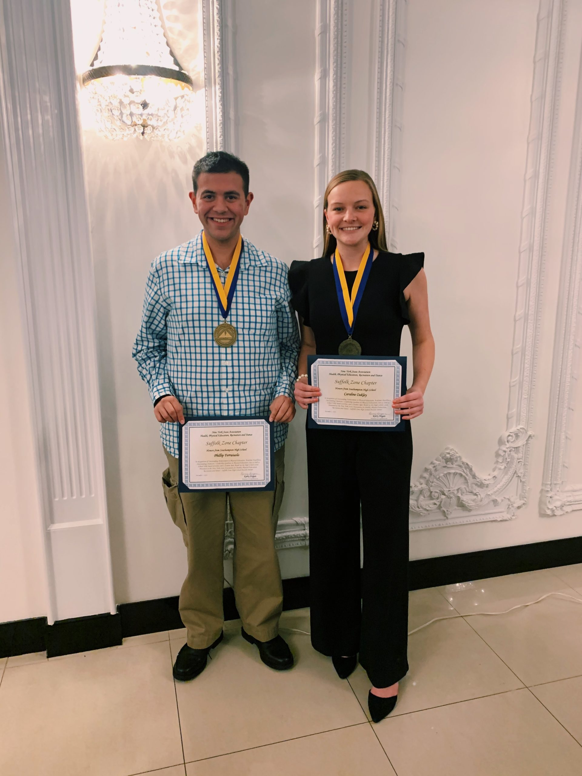 Southampton High School seniors Phillips Ferraiuolo and Caraline Oakley were honored by the New York State Association for Health, Physical Education, Recreation and Dance on December 3 as winners of the Suffolk Zone Student Leadership Award. The pair were selected based upon their excellence in physical education, leadership ability and service to the community.