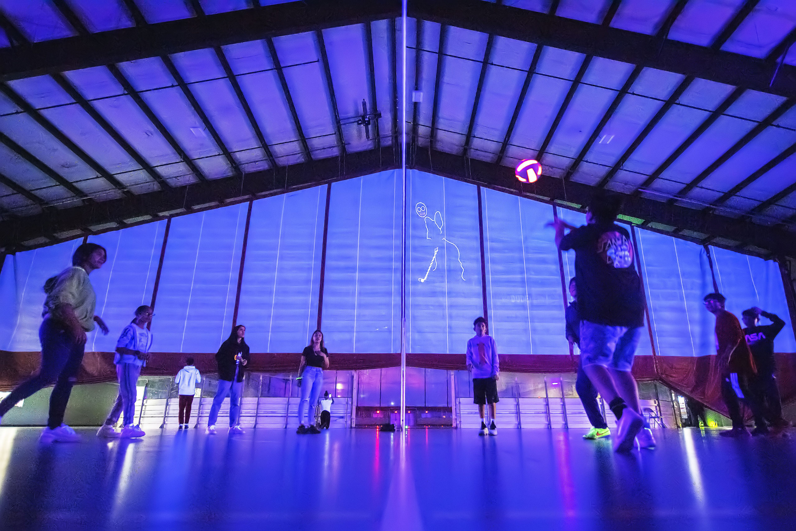 Kids play volleyball during the Lights Out! Glow Night event at the SYS facility in Southampton on Friday night. MICHAEL HELLER