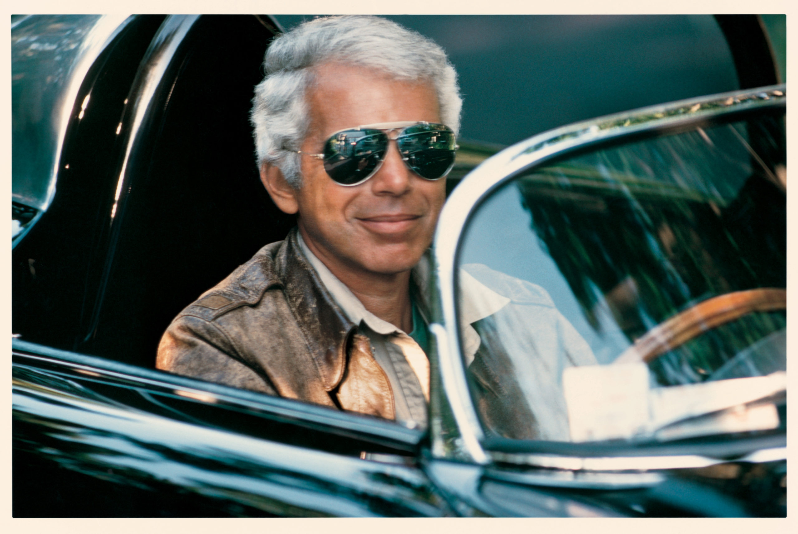 Ralph Lauren (50s) in his car.
