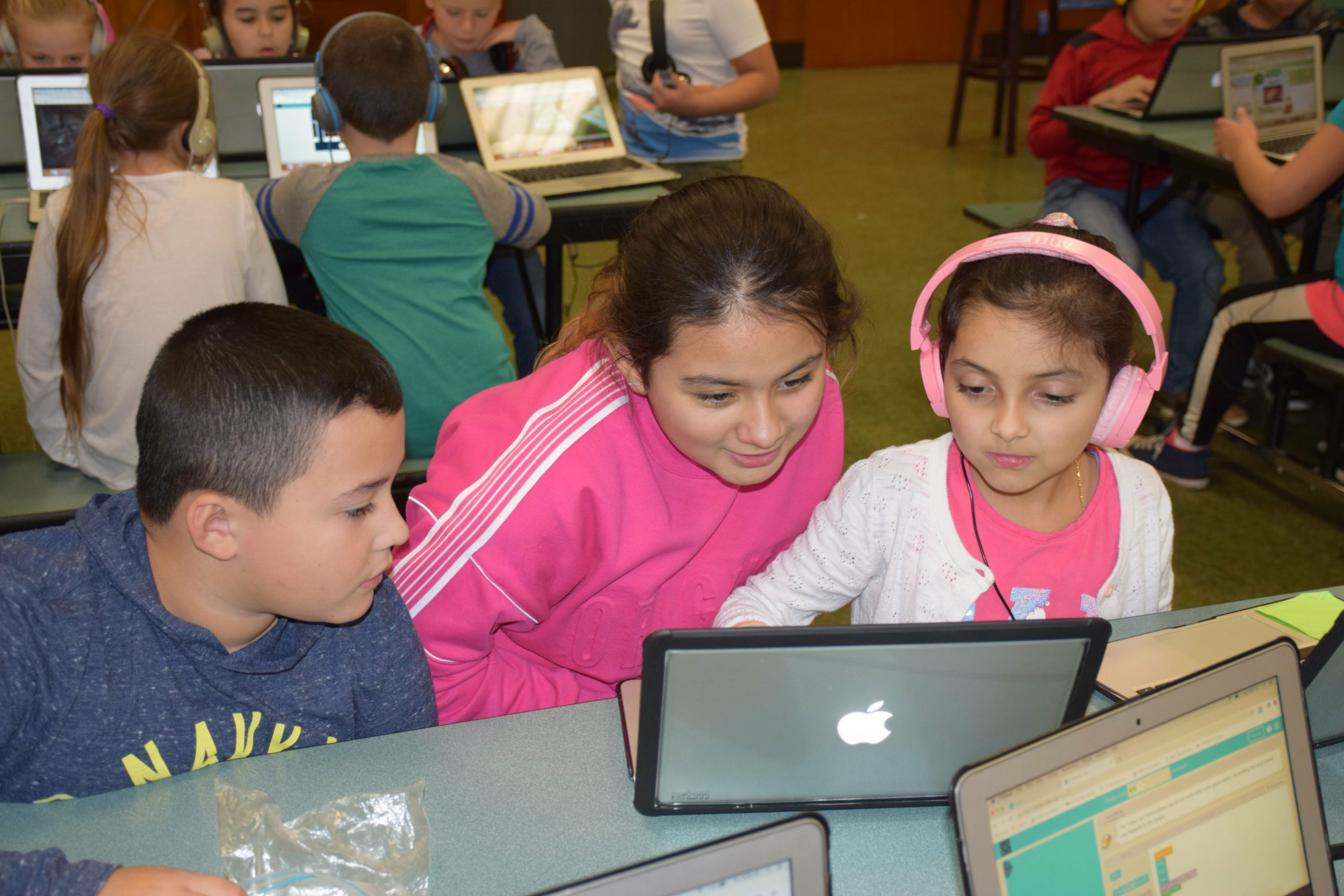 Westhampton Beach Elementary School students, including, from left, Brian Cruz Cordova, Fabiana Rodriquez Flores and Kenna Rogue Gutierrez, participated in an Hour of Code during Computer Science Education Week.