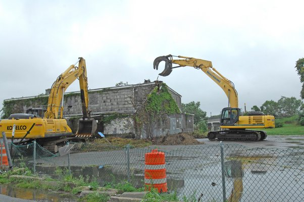 Demolition of the buildings on Ferry Road in Sag Harbor began on Monday morning.    DANA SHAW