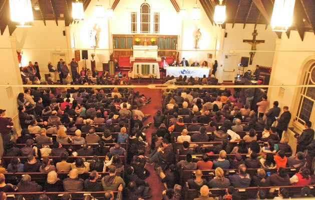 Hundreds of people packed the Queen of the Most Holy rosary Church in Bridgehampton on Tuesday evening for a forum hosted by OLA.  DANA SHAW