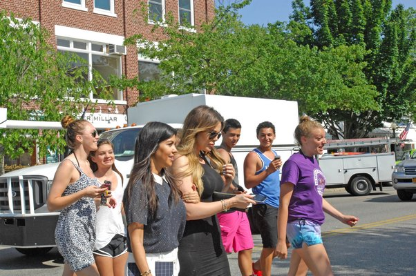 Hundreds of people protested in Hampton Bays on Thursday afternoon. AMANDA BERNOCCO