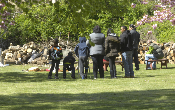 Mourners gather at the site of the fatal crash on the Shinnecock Indian Reservation on Saturday morning. A vigil was held.  DANA SHAW