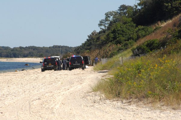 Investigators were on the scene at Cold Spring Point Beach on Wednesday morning.  DANA SHAW