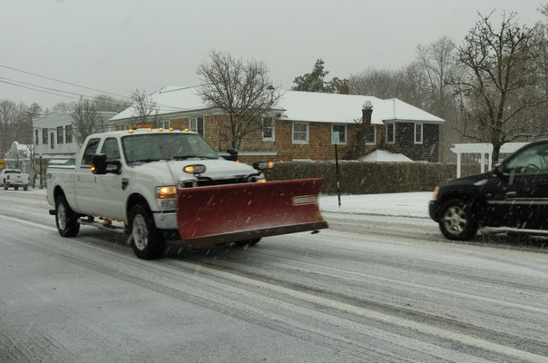 Plows were out in full force on Thursday morning as a winter storm bears down on the area.  DANA SHAW
