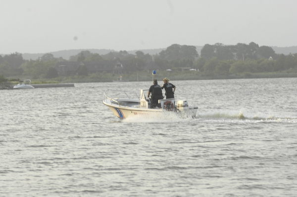 Emergency crews search for a missing jet skier in Mecox Bay on Sunday evening.  DANA SHAW