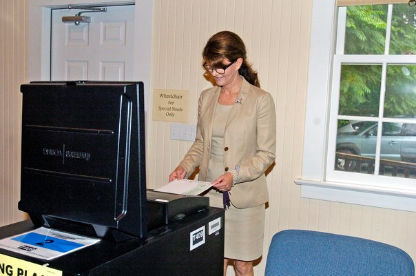 Democratic Congressional candidate Anna Throne-Holst votes at the Community Bible Church in Noyac on Tuesday morning.  DANA SHAW