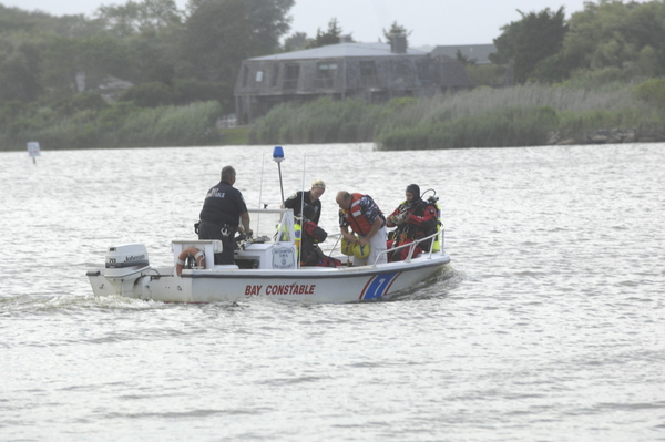 Emergency crews search for a missing jet skier in Mecox Bay on Sunday ev