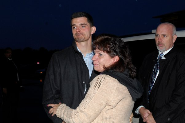 Anthony Oddone is reunited with his mother after posting bail in December.