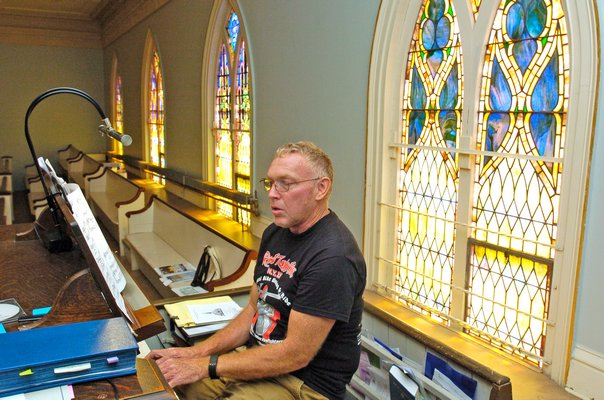 Organist Thomas White decribes the inner workings of the pipe organ.  DANA SHAW