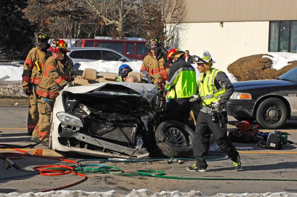 The Southampton Fire Department work to extricate the drive of the accident on County Road 39 this afternoon.  DANA SHAW